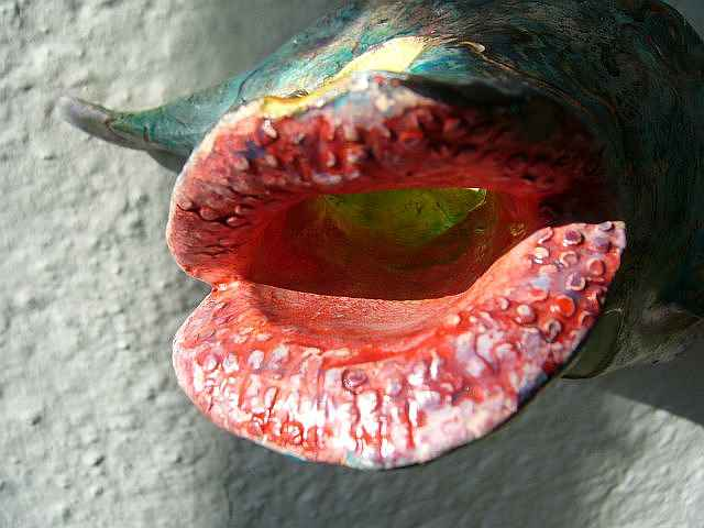 fishy sculpture with big red wet lips