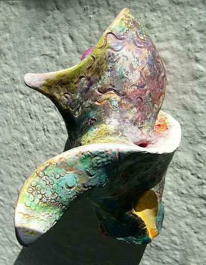 Abstract ceramic sculpture with spiral finlike shapes.  Click to enlarge.