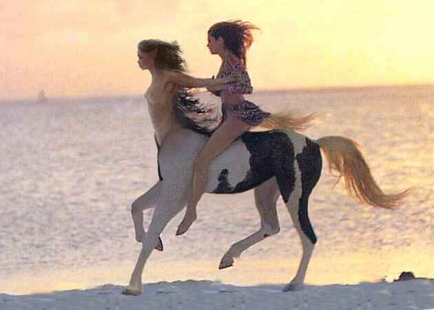 Two sisters of an equine/human mixed-race family gallop on a beach at sunset, one a centaur, one bipedal but tailed. Click to enlarge.