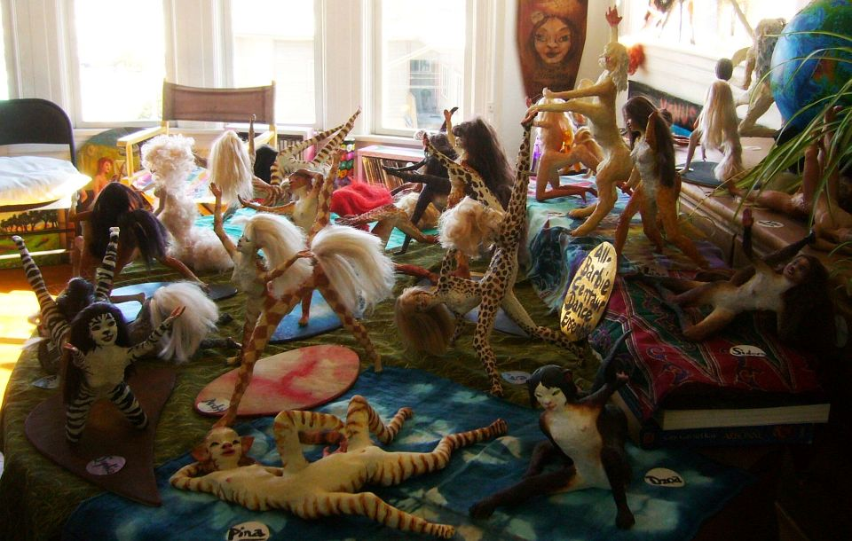 Table covered with figurines by Wayan: the All Barbie Centaur Dance Ensemble.