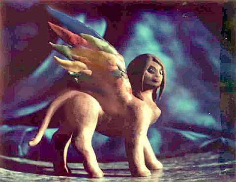 A plasticine model of a sphinx with multicolored wings, made for claymation.