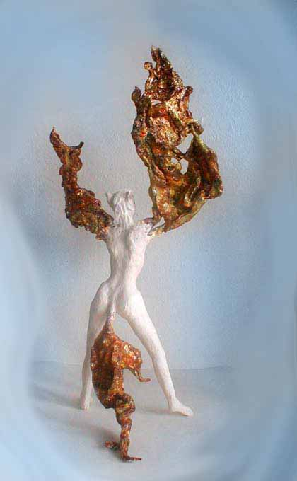 a coyote-headed shapeshifter from the back, caught as her arms stretch into wings. Sculpture by Wayan. Click to enlarge
