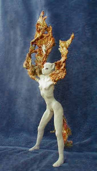 a coyote-headed shapeshifter caught just as her arms stretch into smoky wings. Sculpture by Wayan. Click to enlarge.