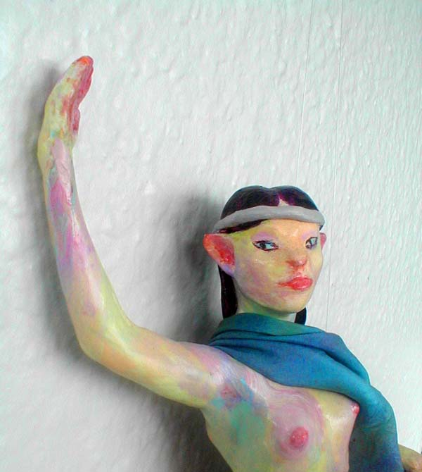 close-up of Elven-dancer in blue cloak; a hanging sculpture. Click to enlarge.
