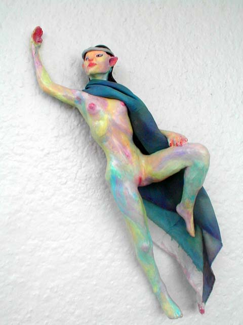An Elven dancer leaping, in blue cloak; a hanging sculpture. Click to enlarge.