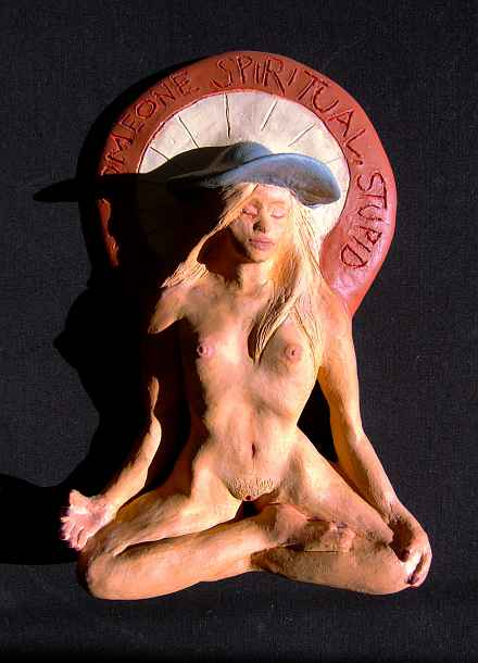 sculpture of woman meditating in a full lotus position, naked except for a floppy hat. Motto above in red white and blue: 'Find Someone Spiritual, Stupid!' Click to enlarge.