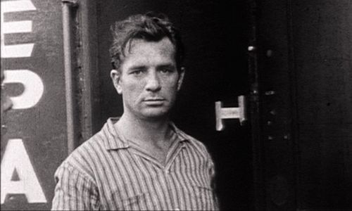 photo of writer Jack Kerouac by a train.