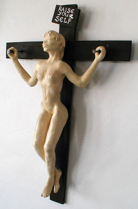 apparently crucified girl raising herself up off the cross. Sculpture by Wayan. Click to enlarge.