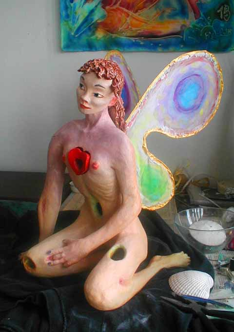 dream sculpture of a fairy girl full of holes, 3/4face.  Click to enlarge.