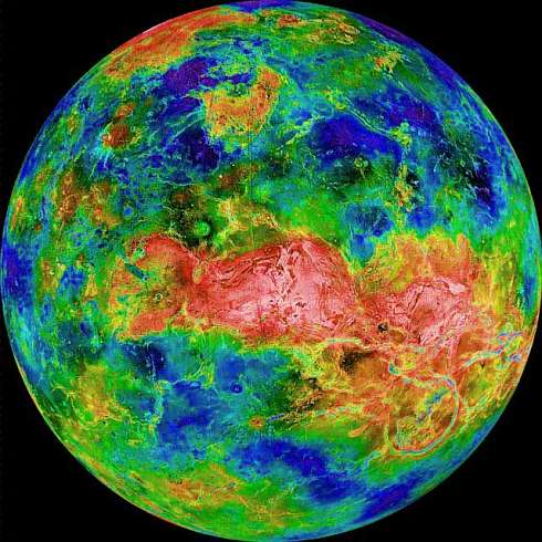 Radar scan of Venus: light is rough, dark is smooth, blue is low, red is high. Red dragonshape along equator is the highlands of Aphrodite: Thetis and Ovda.